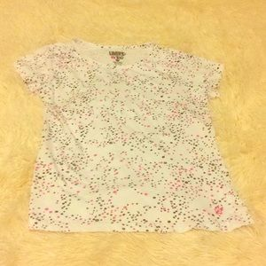 Other - A small, white, patterned T-Shirt.